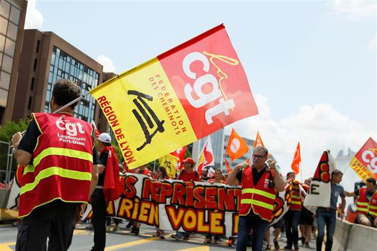 Striking French SNCF railway employees and labor union members attend a demonstration to protest the French government's reform bill in Lyon, France, June 12, 2018.