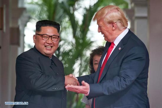 Top leader of the Democratic People's Republic of Korea (DPRK) Kim Jong Un (L) meets with U.S. President Donald Trump in Singapore, on June 12, 2018. (Xinhua/The Straits Times)