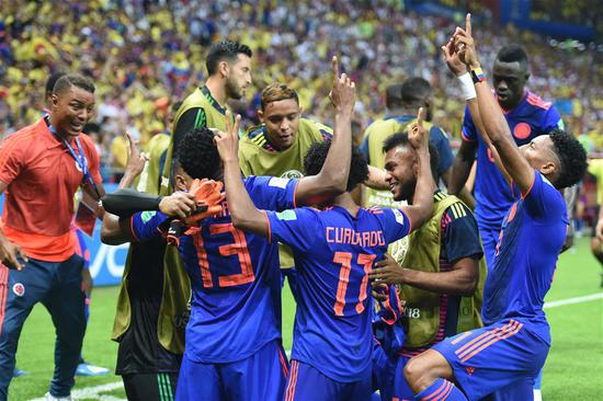Players of Colombia celebrate Yerry Mina's goal during the 2018 FIFA World Cup Group H match between Poland and Colombia in Kazan, Russia, June 24, 2018. (Xinhua/He Canling)
