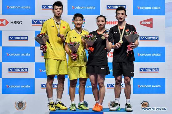 Zheng Siwei (1st R) and Huang Yaqiong (2nd R) pose with Wang Yilyu (1st L) and Huang Dongping of China during the awarding ceremony after their mixed doubles final match at the Malaysia Badminton Open 2018 in Kuala Lumpur, Malaysia, July 1, 2018. Zheng Siwei and Huang Yaqiong won 2-0 to claim the title. (Xinhua/Chong Voon Chung)