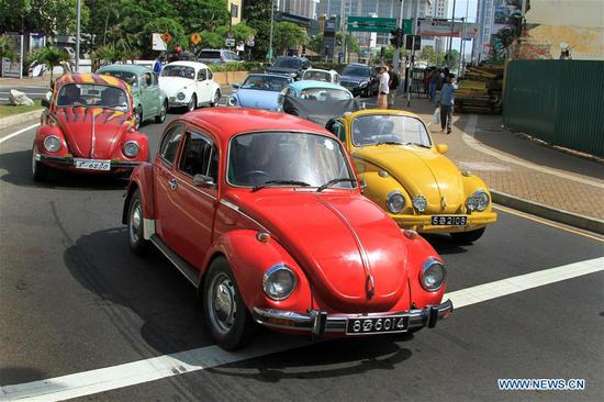 Volkswagen cars take part in a grand parade on the streets of Colombo, Sri Lanka, July 1, 2018. The Volkswagen Beetle Owners' Club held an annual World Volkswagen Day celebration in Colombo on Sunday. (Xinhua/Ajith Perera)