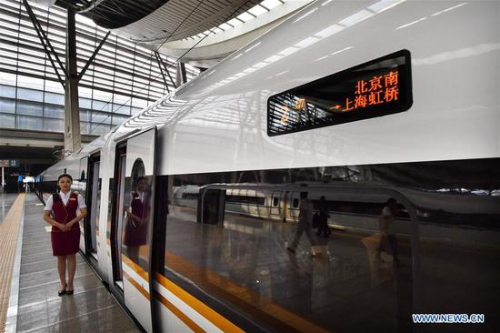 The G7 new longer Fuxing bullet train stops at the Beijing South Railway Station in Beijing, capital of China, July 1, 2018. The new longer Fuxing bullet train ran on the Beijing-Shanghai line for the first time on Sunday. With a designed speed of 350 kilometers per hour, the new train measures more than 400 meters in length and has 16 carriages, twice as many as current ones. It can carry nearly 1,200 passengers. (Xinhua/Yang Baosen)