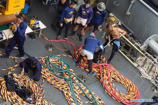 Members of Thai rescue team prepare to search for missing passengers from the capsized boat in the accident area in Phuket, Thailand, July 8, 2018. At least 42 people were confirmed dead and 14 others still missing after two boats capsized in a storm off southern Thailand's Phuket island, Thai officials said on Saturday. (Xinhua/Qin Qing)