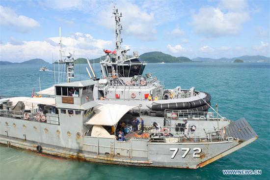A Thai navy vessel departs to search for missing passengers from the capsized boat in Phuket, Thailand, July 8, 2018. At least 42 people were confirmed dead and 14 others still missing after two boats capsized in a storm off southern Thailand's Phuket island, Thai officials said on Saturday. (Xinhua/Qin Qing)
