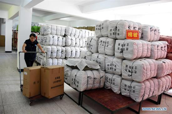 An official prepares relief materials at Yongding District of Longyan City, southeast China's Fujian Province, July 9, 2018. A yellow-level alert has been issued and third-level emergency response has been activated to cope with approaching typhoon Maria, the eighth typhoon this year, in China's coastal provinces. (Xinhua/Su Gaolong)