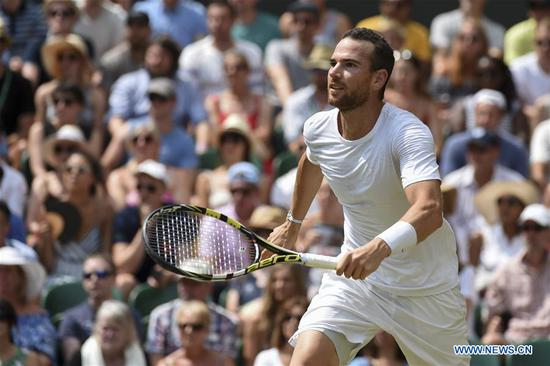 Adrian Mannarino of France competes during the men's singles fourth round match against Roger Federer of Switzerland at the Wimbledon Championships 2018 in London, Britain, on July 9, 2018. Adrian Mannarino lost 0-3. (Xinhua/Stephen Chung)