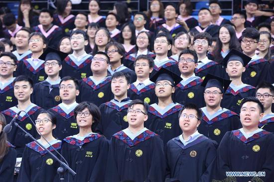 Graduates attend the commencement ceremony of Peking University in Beijing, China, July 10, 2018. A total of 3,313 students graduated from the Peking University and attained the degree of bachelor in 2018. (Xinhua)