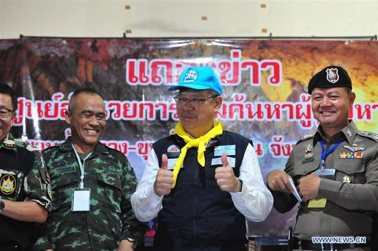 Narongsak Osatanakorn (2nd R), head of the joint command center coordinating the rescue operation, reacts at a press briefing in Chiang Rai, Thailand, July 10, 2018. All 12 boys and their football coach have been rescued from a flooded cave in northern Thailand after being trapped for 18 days, rescuers said on Tuesday. The 12 young footballers, aged between 11 and 16, and their 25-year-old coach went missing during an excursion in Tham Luang cave in northern Thailand's Chiang Rai Province since June 23. (Xinhua/Rachen Sageamsak)