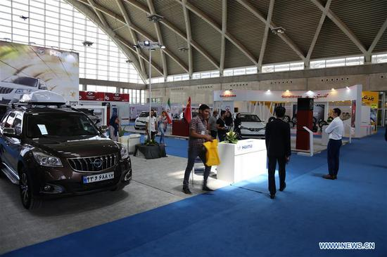People visit the China Auto Parts & Accessories (Iran) Exhibition, in Tehran, Iran, on July 10, 2018. More than 100 enterprises from China, Iran, Turkey and other countries and regions will display their auto vehicles and parts during the four-day event. (Xinhua/Mu Dong)