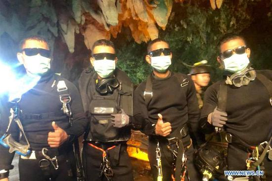 Photo released by Royal Thai Navy on July 10, 2018 shows the last four Thai Navy SEAL divers coming out safely after completing the rescue mission inside the Tham Luang cave, in Chiang Rai, Thailand. All 12 boys and their football coach have been rescued from a flooded cave in northern Thailand after being trapped for 18 days, rescuers said on Tuesday. The 12 young footballers, aged between 11 and 16, and their 25-year-old coach went missing during an excursion in Tham Luang cave in northern Thailand's Chiang Rai Province since June 23. (Xinhua)
