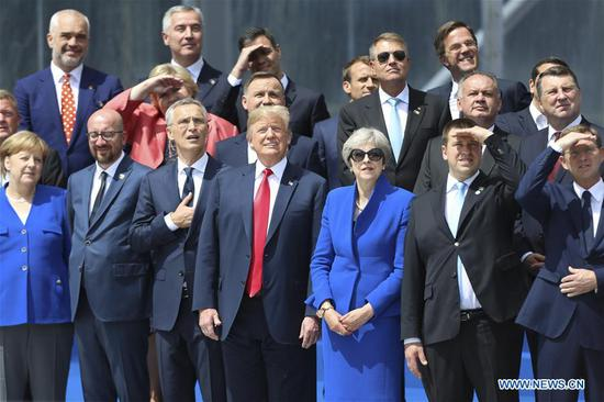 Leaders observe a helicopter flypast during a NATO summit in Brussels, Belgium, July 11, 2018. NATO leaders gather in Brussels for a two-day meeting. (Xinhua/Ye Pingfan)