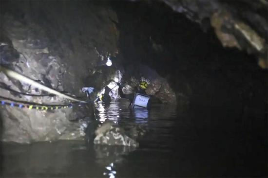 "This handout video grab taken from footage released by the Royal Thai Navy on July 11, 2018 shows a rescue diver during the rescue operation for members of the ""Wild Boars"" Thai youth football team inside the Tham Luang cave in Khun Nam Nang Non Forest Park in Mae Sai district."