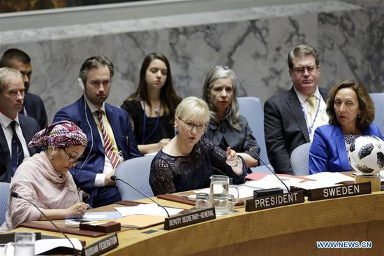 Swedish Foreign Minister Margot Wallstrom (C, Front), whose country holds the presidency of the Security Council for July, speaks at the UN Security Council high-level debate on climate-related security risks at the UN headquarters in New York, on July 11, 2018. UN Deputy Secretary-General Amina Mohammed on Wednesday highlighted the link between climate change and international peace and security and called for collective action. (Xinhua/Li Muzi)
