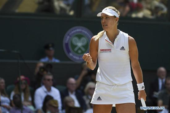 Angelique Kerber of Germany celebrates victory after the ladies' singles semi-final match against Jelena Ostapenko of Latvia at the Wimbledon Championships 2018 in London, Britain, on July 12, 2018. Angelique Kerber won 2-0. (Xinhua/Stephen Chung)