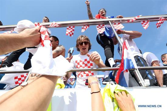 Members of Croatian national football team ride on a bus from the airport to the city center in Zagreb, capital of Croatia, on July 16, 2018. Croatia won the second place in 2018 FIFA World Cup in Russia on Sunday. (Xinhua/Robert Anic)