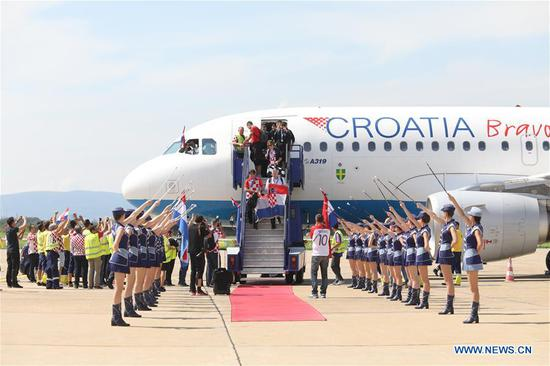 Members of Croatian national football team get off the flight from Moscow to Zagreb at Dr. Franjo Tudjman Airport in Zagreb, capital of Croatia, on July 16, 2018. Croatia won the second place at the 2018 FIFA World Cup in Russia on Sunday. (Xinhua/Patrik Macek)