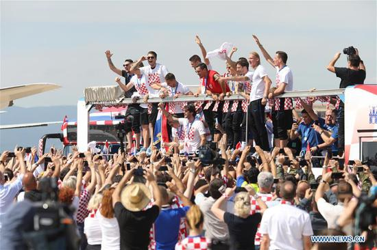 Photo taken on July 16, 2018 shows members of Croatian national football team on a bus after arriving at Dr. Franjo Tudjman Airport in Zagreb, capital of Croatia. Croatia won the second place at the 2018 FIFA World Cup in Russia on Sunday. (Xinhua/Patrik Macek)