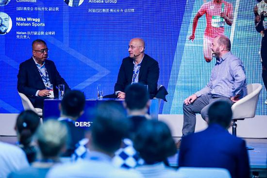 Leon Xie, General Manager of Olympic business team of Alibaba Group (left), Christian Voigt,