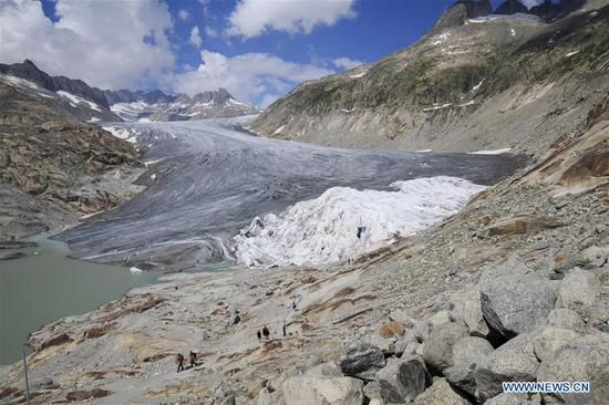 Photo taken on Aug. 5, 2018 shows the Rhone Glacier covered with white blankets near the Furka Pass in Switzerland. The Rhone Glacier is protected by special white blankets to prevent it from further melting as a result of global warming. (Xinhua/Xu Jinquan)