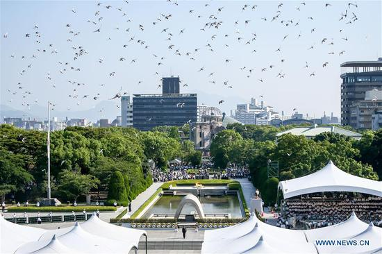 Pigeons fly over the Peace Memorial Park in Hiroshima, Japan, on Aug. 6, 2018. Japan on Monday marked the 73rd anniversary of the atomic bombing of Hiroshima. (Xinhua/Ma Caoran)