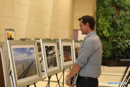 A visitor views photos at the photo exhibition