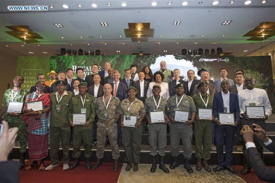 Honor guests and African rangers pose for a group photo during the 2018 Ranger Awards ceremony in Cape Town, South Africa, on Aug. 7, 2018. The African Ranger Awards were launched by the Alibaba Foundation together with the Paradise Foundation in July this year. Under the initiative that will last 10 years, 50 wildlife rangers will be awarded each year, with a prize of 3,000 U.S. dollars each. (Xinhua/Chen Cheng)