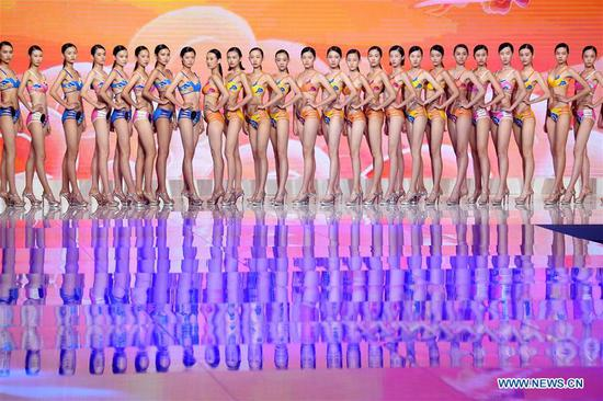 Contestants pose in the swimwear session during the 13th China Super Model Final Contest in Qingdao, east China's Shandong Province, Aug. 26, 2018. (Xinhua/Li Ziheng)