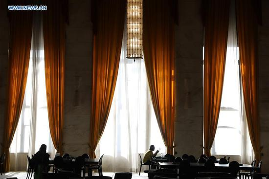 Journalists rest in the press room of the 75th Venice International Film Festival in Venice Lido, Italy, Aug. 28, 2018. (Xinhua/Cheng Tingting)