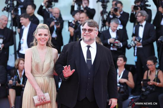 Competition jury president Guillermo Del Toro (R) and Kim Morgan pose on the red carpet of the 75th Venice International Film Festival in Venice, Italy, Aug. 29, 2018. The 75th Venice International Film Festival kicked off here on Wednesday. (Xinhua/Cheng Tingting)