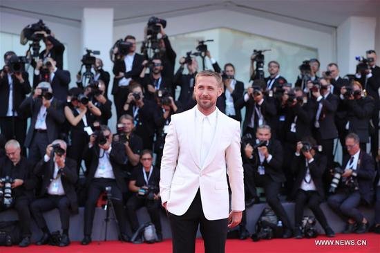 Actor Ryan Gosling poses on the red carpet of the 75th Venice International Film Festival in Venice, Italy, Aug. 29, 2018. The 75th Venice International Film Festival kicked off here on Wednesday. (Xinhua/Cheng Tingting)