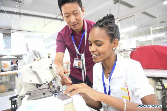 An Ethiopian worker of ANTEX Fashion Group learns sewing skill at a plant in Huzhou, east China's Zhejiang Province, Aug. 30, 2018. In 2017, Zhejiang's ANTEX Fashion Group set a branch in Ethiopia. To build a better team, the Ethiopian branch has sent 93 Ethiopian workers to China for six-month training. Besides learning production skills, these workers also learnt Chinese language, calligraphy and martial art in spare time.