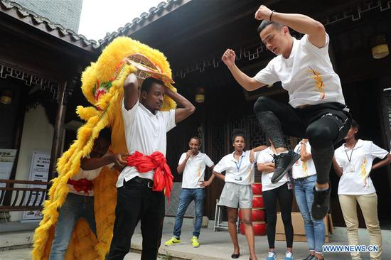 Ethiopian workers of ANTEX Fashion Group learn lion dancing in Qianyuan Township of Deqing County, east China's Zhejiang Province, Aug. 30, 2018. In 2017, Zhejiang's ANTEX Fashion Group set a branch in Ethiopia. To build a better team, the Ethiopian branch has sent 93 Ethiopian workers to China for six-month training. Besides learning production skills, these workers also learnt Chinese language, calligraphy and martial art in spare time.