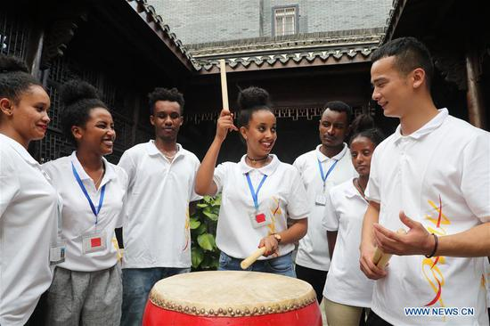 Ethiopian workers of ANTEX Fashion Group learn drum playing in Qianyuan Township of Deqing County, east China's Zhejiang Province, Aug. 30, 2018. In 2017, Zhejiang's ANTEX Fashion Group set a branch in Ethiopia. To build a better team, the Ethiopian branch has sent 93 Ethiopian workers to China for six-month training. Besides learning production skills, these workers also learnt Chinese language, calligraphy and martial art in spare time.
