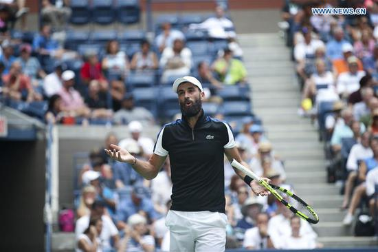 Benoit Paire of France reacts during the men's singles second round match against Roger Federer of Switzerland at the 2018 US Open tennis Championships in New York, the United States, Aug. 30, 2018. Benoit Paire lost 0-3. (Xinhua/Wang Ying)