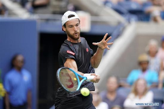 Joao Sousa of Portugal hits a return during the men's singles fourth round match against Novak Djokovic of Serbia at the 2018 US Open in New York, the United States, Sept. 3, 2018. Djokovic won 3-0. (Xinhua/Li Muzi)