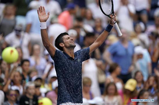 Novak Djokovic of Serbia celebrates after winning the men's singles fourth round match against Joao Sousa of Portugal at the 2018 US Open in New York, the United States, Sept. 3, 2018. Djokovic won 3-0. (Xinhua/Li Muzi)