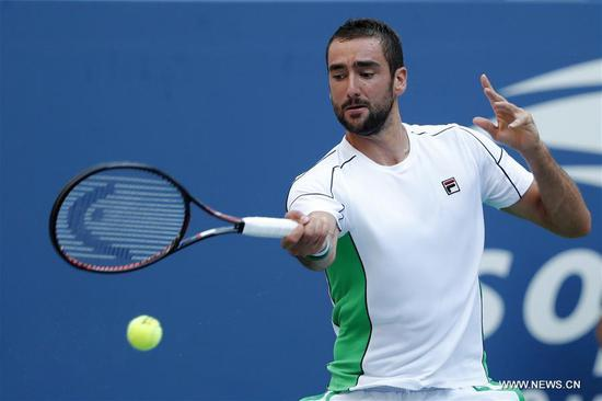 Marin Cilic of Croatia hits a return during the men's singles fourth round match against David Goffin of Belgium at the 2018 US Open in New York, the United States, Sept. 3, 2018. Cilic won 3-0. (Xinhua/Li Muzi)