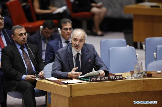 """Syrian Ambassador to the United Nations Bashar Ja'afari (front) speaks at a Security Council meeting on the situation in Idlib at the UN headquarters in New York, Sept. 7, 2018. The UN special envoy for Syria said Friday that the situation there had all the """"ingredients"""" for a """"perfect storm"""" with devastating humanitarian consequences, urging all stakeholders to find a solution to avert a tragedy. (Xinhua/Li Muzi)"""