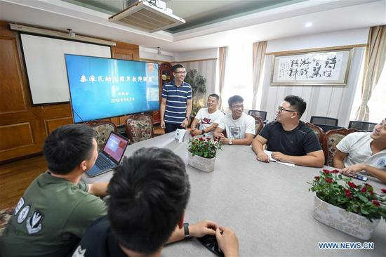 Guo Xinwang (2nd R, back) attends a male teacher meeting in Nanjing, capital of east China's Jiangsu Province, Sept. 5, 2018. Xiaoxihu kindergarten in Nanjing, capital of east China's Jiangsu Province, Sept. 6, 2018. Guo, born in 1993 and graduated from the Jiangsu Normal University, became the first and only male teacher of the Xiaoxihu kindergarten three years ago. There are 400 plus male teachers in Nanjing nowadays, up to three percent of the whole teachers working in kindergartens. (Xinhua/Li Bo)