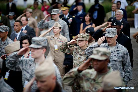 Military members and guests attend a ceremony marking the 17th anniversary of the Sept. 11 attacks at the Pentagon in Arlington, Virginia, the United States, on Sept. 11, 2018. Memorials were held across the United States on Tuesday to mark the 17th anniversary of the Sept. 11 attacks. (Xinhua/Ting Shen)
