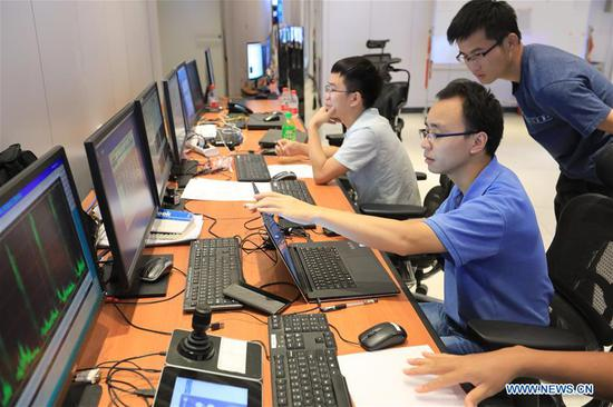 Staff members work at a control center of China's Five-hundred-meter Aperture Spherical Radio Telescope (FAST) in southwest China's Guizhou Province, Sept. 10, 2018. FAST has discovered 44 new pulsars so far. (Xinhua/Ou Dongqu)