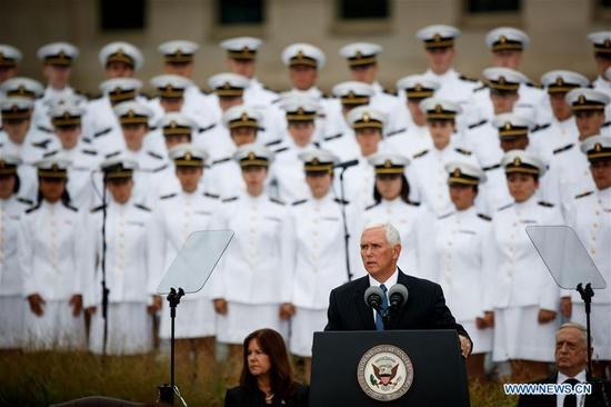 U.S. Vice President Mike Pence (Front) speaks during a ceremony marking the 17th anniversary of the Sept. 11 attacks at the Pentagon in Arlington, Virginia, the United States, on Sept. 11, 2018. Memorials were held across the United States on Tuesday to mark the 17th anniversary of the Sept. 11 attacks. (Xinhua/Ting Shen)