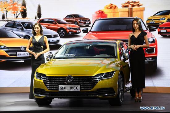 Models show a vehicle during the Auto Qingdao Autumn 2018 in Qingdao, east China's Shandong Province, Sept. 13, 2018. Over 600 exhibitors participated in the six-day auto show. (Xinhua/Li Ziheng)
