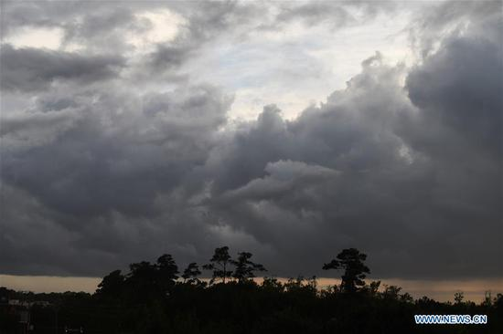 The clouds are seen before the arrival of Hurricane Florence in Wilmington, North Carolina, the United States, on Sept. 12, 2018. Hurricane Florence on Wednesday night weakened to a Category 2 storm over the Atlantic with maximum sustained winds of about 175 km per hour, authorities said. (Xinhua/Liu Jie)