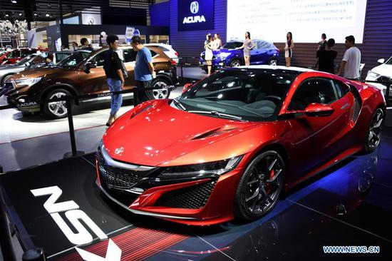 People visit the Auto Qingdao Autumn 2018 in Qingdao, east China's Shandong Province, Sept. 13, 2018. Over 600 exhibitors participated in the six-day auto show. (Xinhua/Li Ziheng)