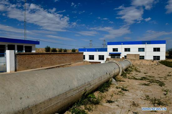 Photo taken on Sept. 6, 2018 shows a pump station in Hejiakouzi Village of Hanjiaoshui Township in Zhongning County, northwest China's Ningxia Hui Autonomous Region. In 2004, a project diverting water from the Yellow River eased Hanjiaoshui's water shortage. Many migrant workers returned hometown. Under the guidance of local government, they planted watermelon and developed cultivation industry. In March of 2017, Ningxia started the construction of another water project to improve water supplies in Hanjiaoshui. (Xinhua/Guo Xulei)