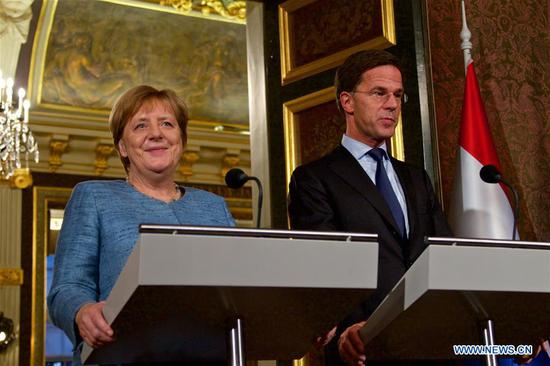 German Chancellor Angela Merkel (L) and Dutch Prime Minister Mark Rutte attend a joint press conference in The Hague, the Netherlands, Oct. 10, 2018. Dutch Prime Minister Mark Rutte and German Chancellor Angela Merkel met in The Hague on Wednesday ahead of the mid-October European Council meeting to discuss, among other subjects, the Brexit. (Xinhua/Sylvia Lederer)