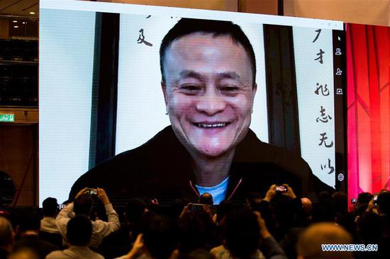 Jack Ma, founder of China's e-commerce giant Alibaba, speaks to audience via video call during the China Conference organized by South China Morning Post in the Malaysia's capital Kuala Lumpur, Oct. 10, 2018. The conference brought together business, academic and political leaders to discuss cooperation between China and Southeast Asia on politics, economy, technology and how to tap opportunities of the Belt and Road Initiative, among others. (Xinhua/Zhu Wei)