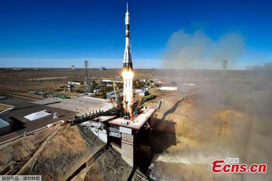 Russia's Soyuz MS-10 spacecraft carrying the members of the International Space Station (ISS) expedition 57/58, Russian cosmonaut Alexey Ovchinin and NASA astronaut Nick Hague, blasts off to the ISS from the launch pad at the Russian-leased Baikonur cosmodrome in Baikonur on October 11, 2018. (Photo/Agencies)