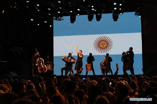 Musicians play the national anthem of Argentina during the closing ceremony of the 2018 Summer Youth Olympic Games at the Youth Olympic Village in Buenos Aires, Argentina, on Oct. 18, 2018. (Xinhua/Li Ming)